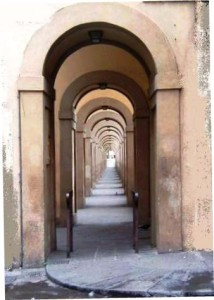 looking down multiple archways of an ancient building what looks like infinity