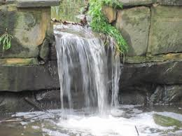 waterfalls in a home garden, referencing how attunement is all about the flow