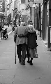 an elderly couple walking arm in arm referencing the spirit within