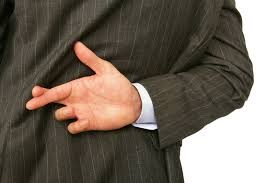 a man in a suit with his fingers crossed behind his back referencing trusting your perceptions