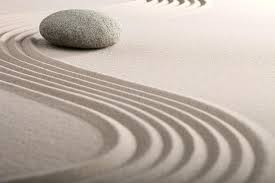 A rock in the sand with a path referencing energy flow