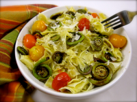 a bowl of pasta with red and yellow cherry tomatoes and fiddleheads referencing FoodWooWoo - Spiritual Nutrition