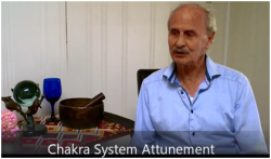 a screenshot from Paul Price's video: chakra system attunement