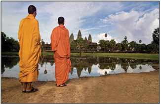 Two monks walking together referencing forgiveness