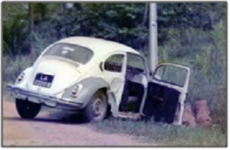 A VW Beetle in a ditch with the front end in a pole referencing listen to the universe