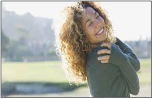 a woman clutching her chest in joy referencing An Open and Loved Heart